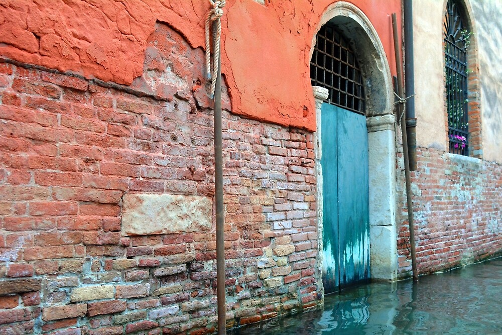 Old wall in Venice, Italy with arched window near the canal by oanaunciuleanu