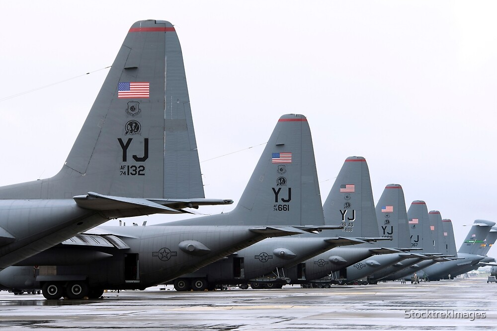 C-130 Hercules on the flightline at Yokota Air Base, Japan. by StocktrekImages