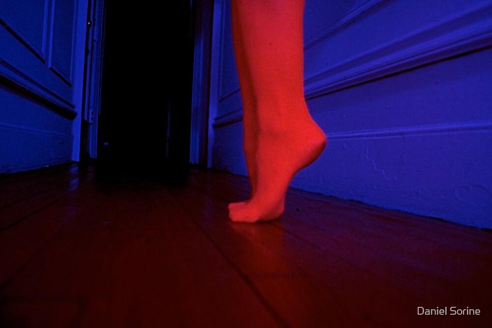 Red feet in hallway by Daniel Sorine