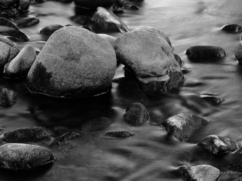 Stones in a stream. by mikeloughlin