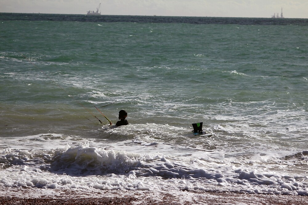 2  kite surfers in the surf by non-stressed