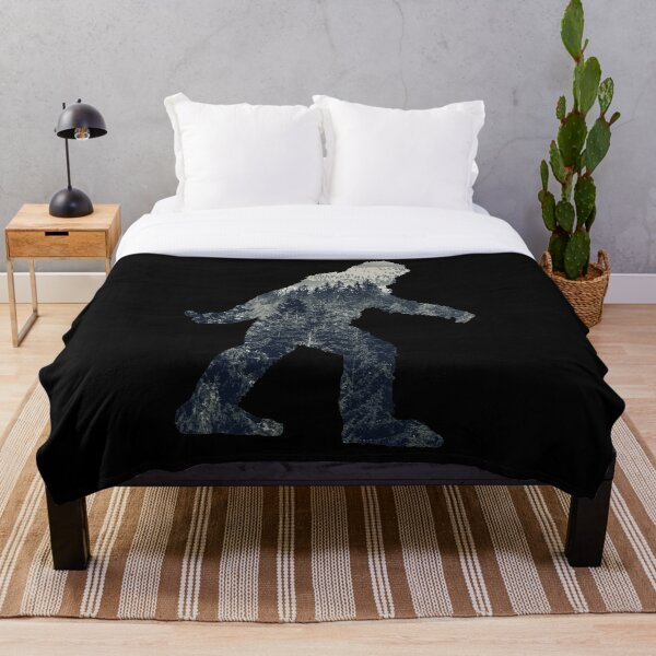 A Sasquatch Silhouette in The North Throw Blanket