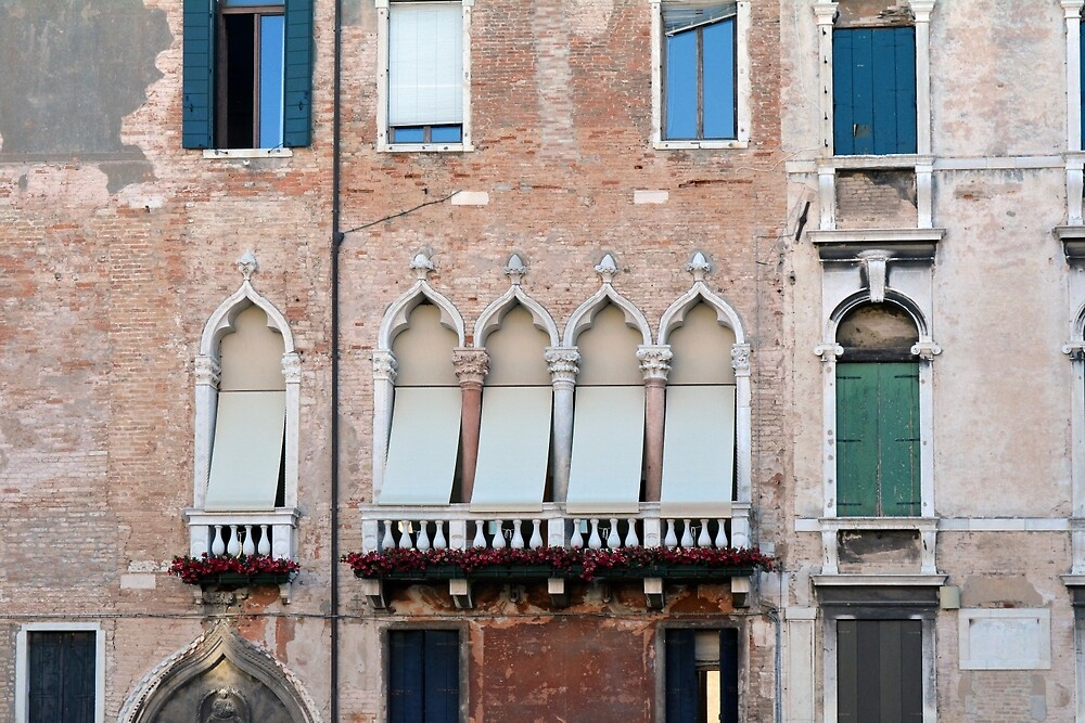 Venetian building facade with windows with arches and shutters by oanaunciuleanu