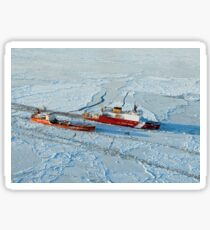 USCG Healy breaks ice around a Russian-flagged tanker south of Nome, Alaska. Sticker