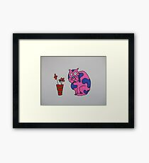 A pink cat with some flowers Framed Print