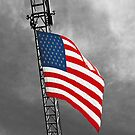 American Flag on a Fire Truck Ladder by Buckwhite