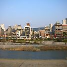 The Kamo River Goes Through The Center of Kyoto City by Glen Sun