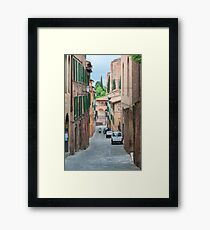 Walkway on in old town in Europe Framed Print