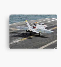 An F/A-18F Super Hornet traps an arresting wire on the flight deck of USS Abraham Lincoln. Canvas Print