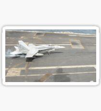 An F/A-18C Hornet lands on the flight deck of USS Nimitz. Sticker