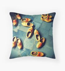 wooden slippers in Holland Throw Pillow