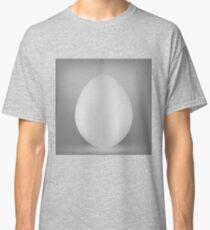 White Organic Egg Isolated on Grey Background. Classic T-Shirt