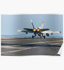 An F/A-18C Hornet lands on the flight deck of USS Harry S. Truman. Poster