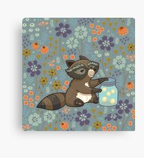 Funny little raccoon collects crickets Canvas Print