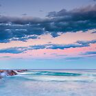 Waves on the breakwater at sunset by Ralph Goldsmith