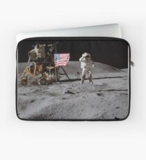 Astronaut saluting the American flag during Apollo 16  by NASA Laptop Sleeve