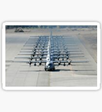 A line of C-130 Hercules taxi at Nellis Air Force Base, Nevada. Sticker