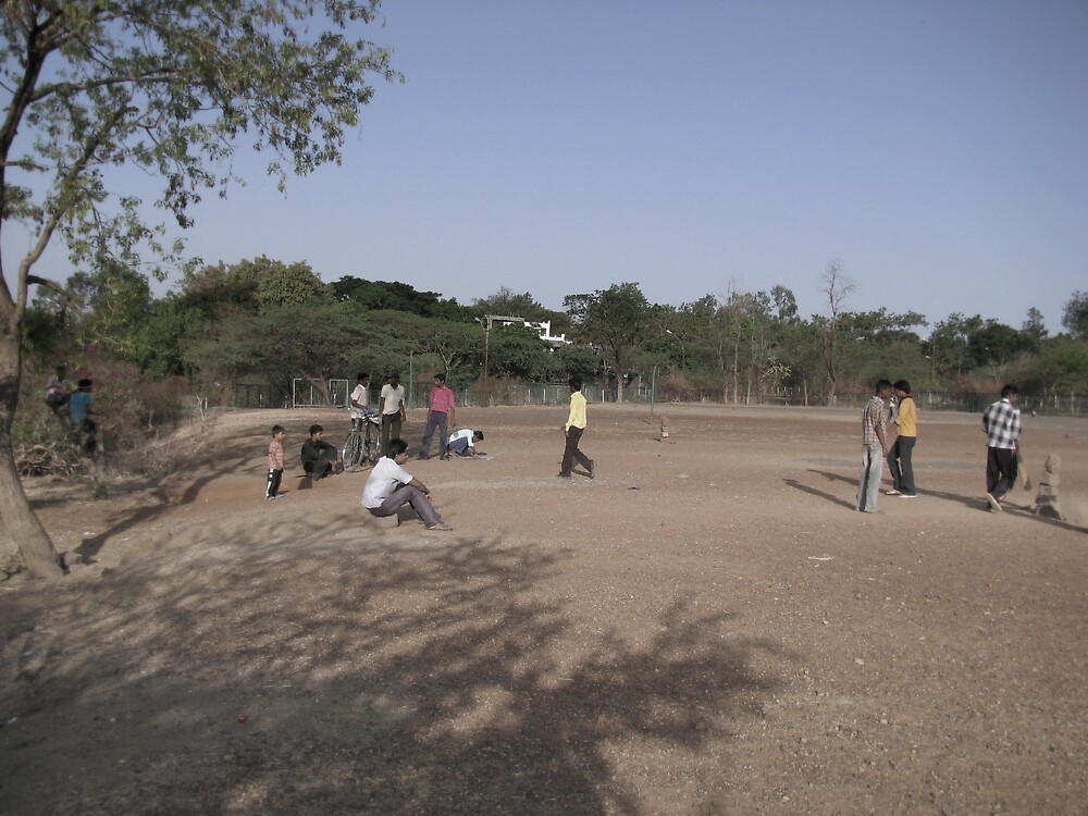 Playing cricket on a Sunday morning with a pile of stones for stumps by nisheedhi