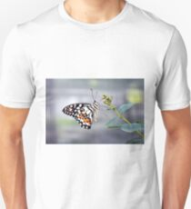 Colorful butterfly with white, black and orange wing decoration on a plant  T-Shirt