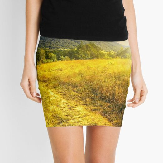 road through a rural meadow on the hillside  at sunset Mini Skirt