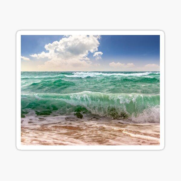 huge sea waves running on sandy beach Sticker