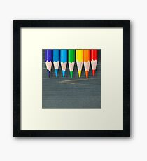 Top view on colored pencils on a blackboard. Macro shot. Framed Print