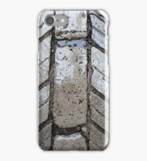 Wet paver blocks of natural stone on a road. iPhone Case/Skin