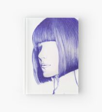Artistic face with blue pen Hardcover Journal