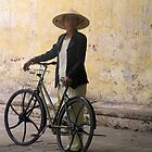 Woman with bicycle, Hoi An by Traveldreams