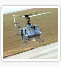 Captain pilots the TH-1H trainer helicopter with instructor pilot. Sticker