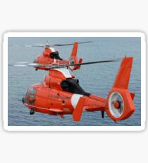 Two Coast Guard HH-65C Dolphin helicopters fly in formation over the Atlantic Ocean. Sticker