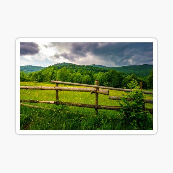 wooden fence on the hillside Sticker