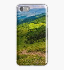 footpath down the hill through forest on mountain ridge iPhone Case/Skin