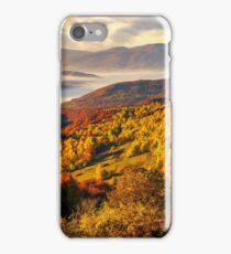 foggy and hot sunrise in Carpathian mountains iPhone Case/Skin