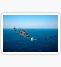 An HH-60 Pave Hawk refuels over the Pacific Ocean. Sticker