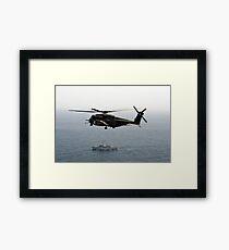 A CH-53 Sea Stallion flies above the mine countermeasures ship USS Ardent. Framed Print