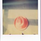 polaroid of red hat  by sleepwalker