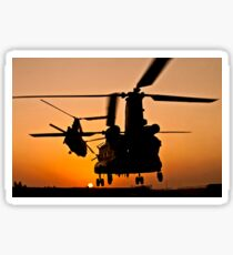 Two Royal Air Force CH-47 Chinooks take off from headquarters in Afghanistan. Sticker