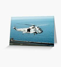 An SH-3H Sea King helicopter prepares to land on USS Saratoga. Greeting Card