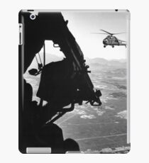 Helicopter and soldier approaching target in Vietnam. iPad Case/Skin
