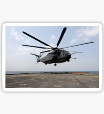 An MH-53E Sea Dragon prepares to land on the flight deck aboard USS Ponce. Sticker