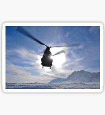 A CH-47 Chinook helicopter takes off from a remote landing zone. Sticker