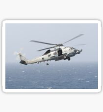 An MH-60R Sea Hawk helicopter prepares to land. Sticker