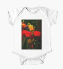 Blooming back lit red and yellow tulip flowers close up Kids Clothes