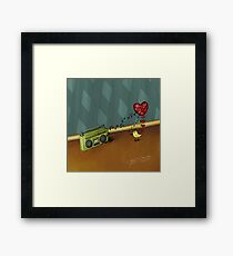 The bird in love with the radio Framed Print