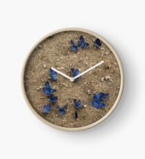 Enchanting Butterflies - Soft Blue Sapphires on the Ground Clock
