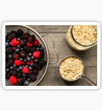 Freshly rinsed berries and uncooked oatmeal Sticker