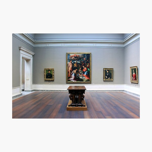 A Room With Four Paintings And A Table Photographic Print