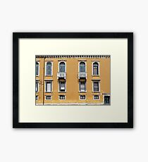 Yellow Italian building facade with window decoration  Framed Print