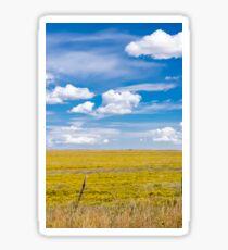 Yellow fields under blue cloudy sky Sticker